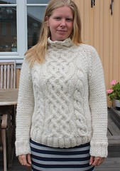 Blonde girl in cabled wool sweater